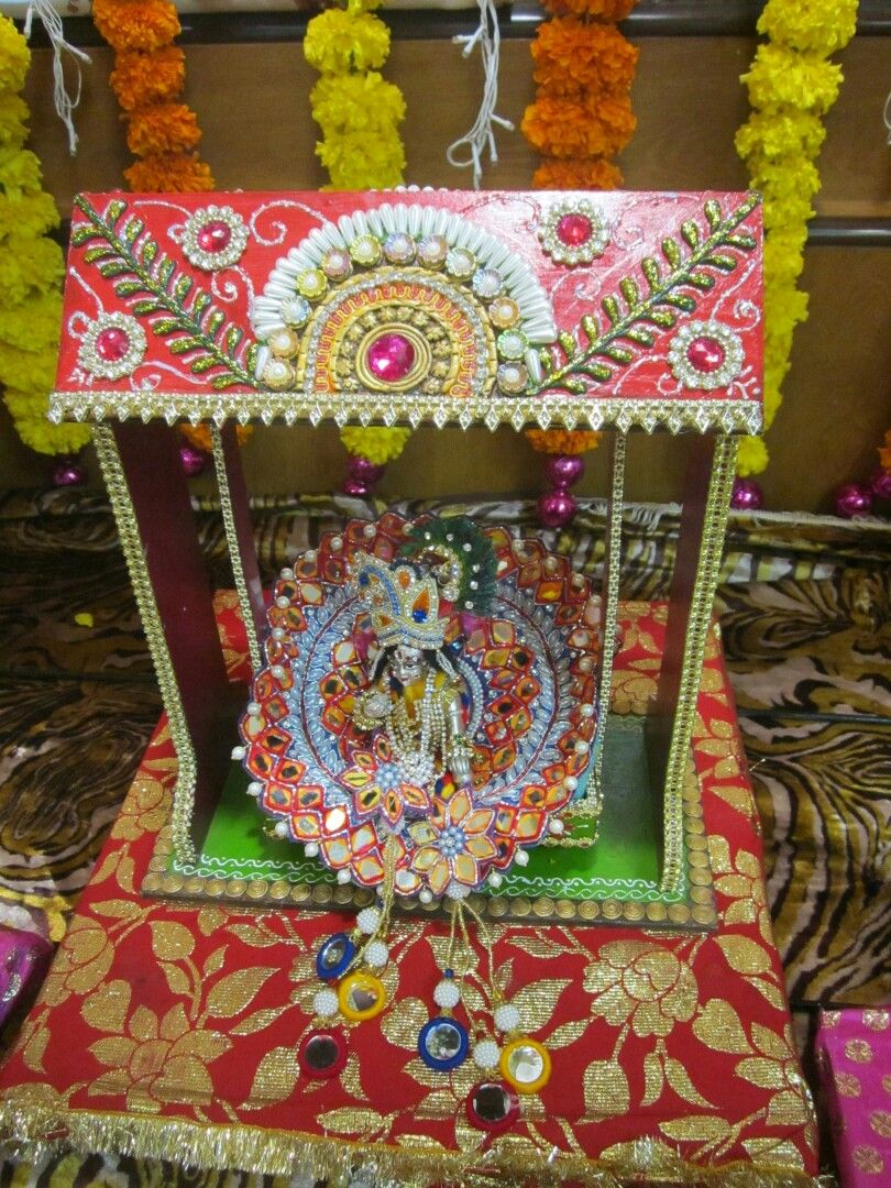 Lord Krishna sitting on the decorated swing