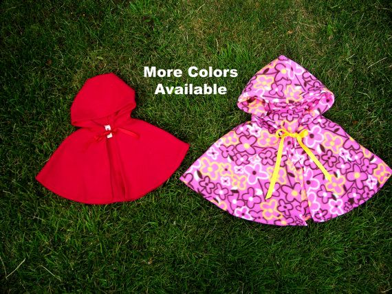 Fleece cape with hood and ribbon ties.  0M, 1-3M, 3-6M, 6-12M, 12-18M, 2T, 3T, 4T, 5, 6, 7, 8, 10, 12, 14, or 16 years.  $20 - $30