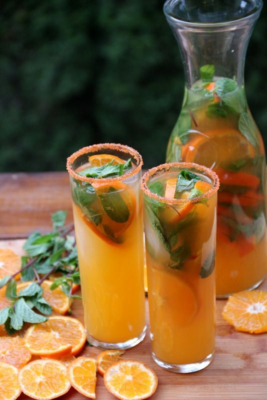 """Tangerine or mandarin mojito - Latin Cocktails - Laylita's Recipes..""""A refreshing tangerine or mandarin mojito recipe made with fresh mandarin juice, lime juice, sugar cane juice or sugar, mint leaves, sparkling water, and rum. Cheers!"""""""