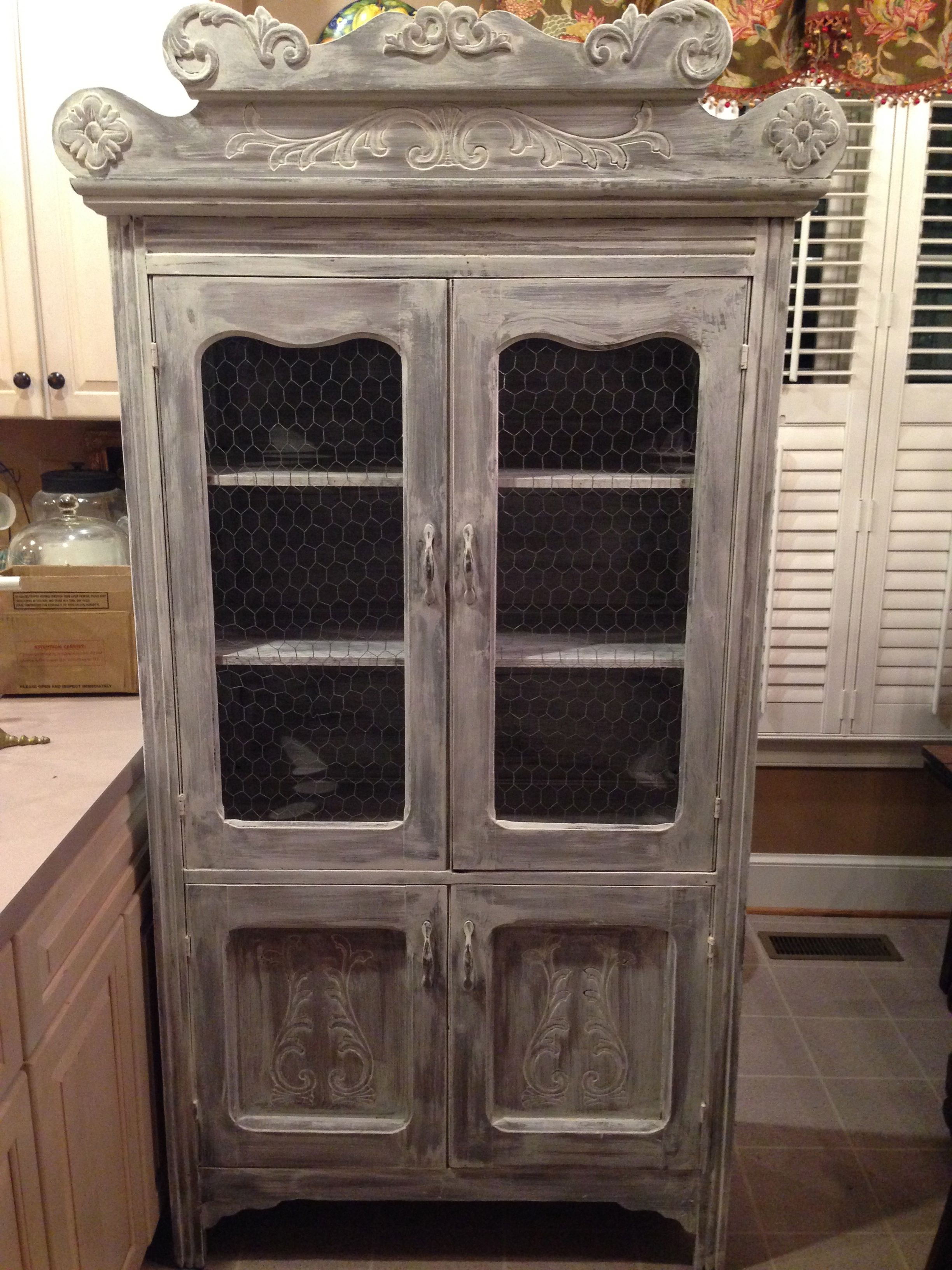 """Whitewashed oak hutch with unique small """"portholes"""" on the sides"""