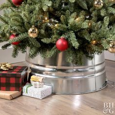 Turn an inexpensive galvanized metal bucket woven basket or cardboard box into functionaland prettyholiday tree collars. #holidaydecor  Turn an inexpensive