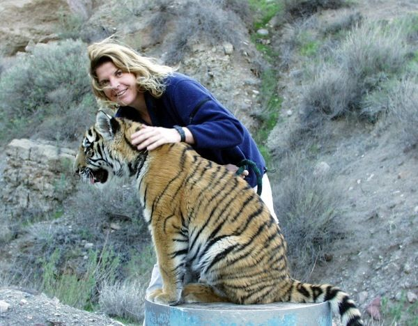 Paw Project founder Jennifer Conrad with one of many tigers she's helped.