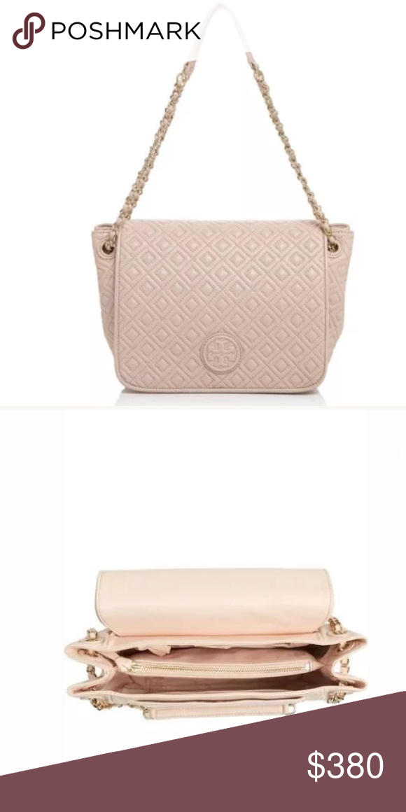"Tory Burch Marion quilted flap shoulder handbag 9 ½""W x 8""H x 3 ½""D 18 ½"" strap drop. Magnetic snap-flap closure. Chain-and-leather shoulder straps. Exterior magnetic-snap pocket. Interior zip divider; zip, wall and smartphone pockets. Logo-jacquard lining. Lambskin leather. Tory Burch Bags Shoulder Bags"
