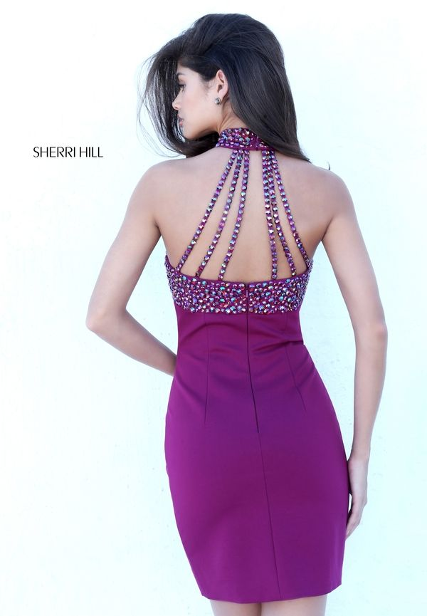 Sherri Hill 50713 is a cocktail dress with a high neckline and a beaded  back.