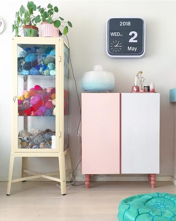 an IKEA Ivar hack with pink legs and pink and white doors ...