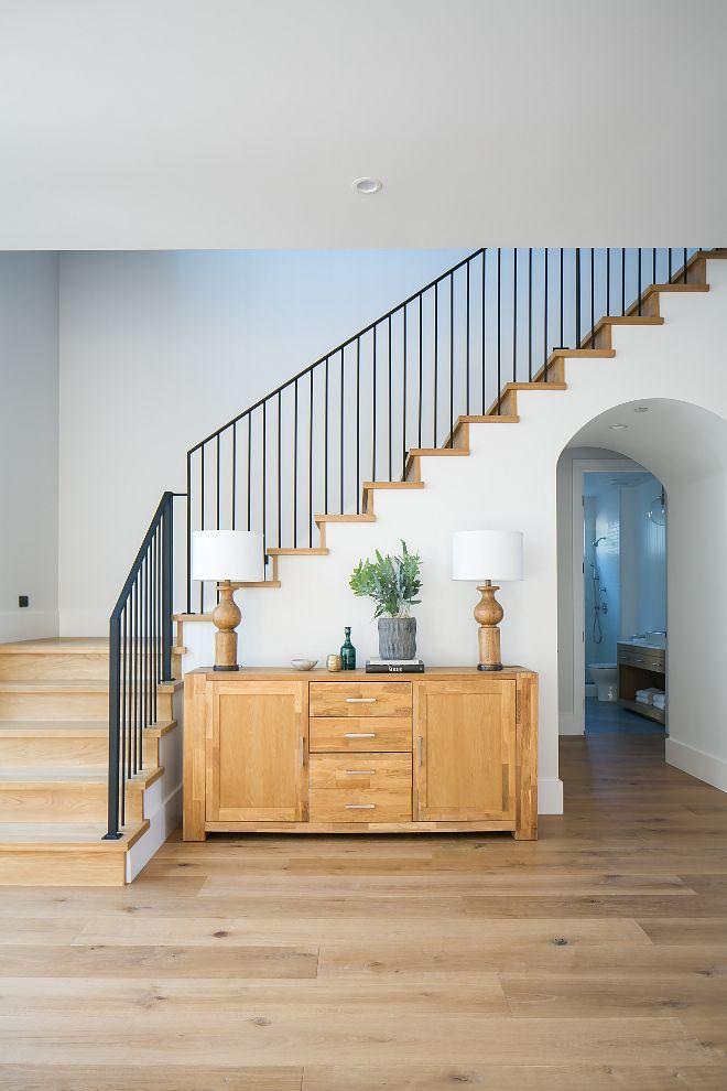 Farmhouse Foyer With Wrought Iron Railing And White Oak Staircase