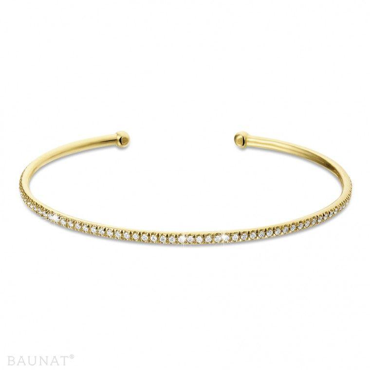 01d6709e8fe0 Brazalete abierto en oro amarillo 18Q con pequeños diamantes redondos de  0.75 Ct en total de