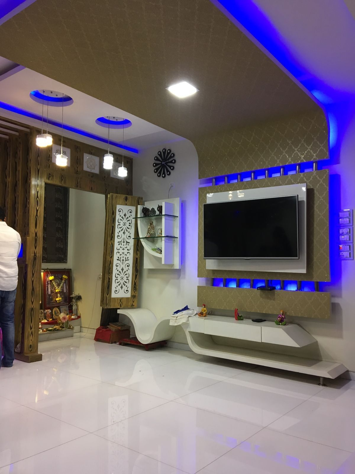 Lcd Wall Units Family Rooms That Exploit The Corner Space Open Up Whatever Is Left Of The Space For M Ceiling Design Modern House Ceiling Design Ceiling Design