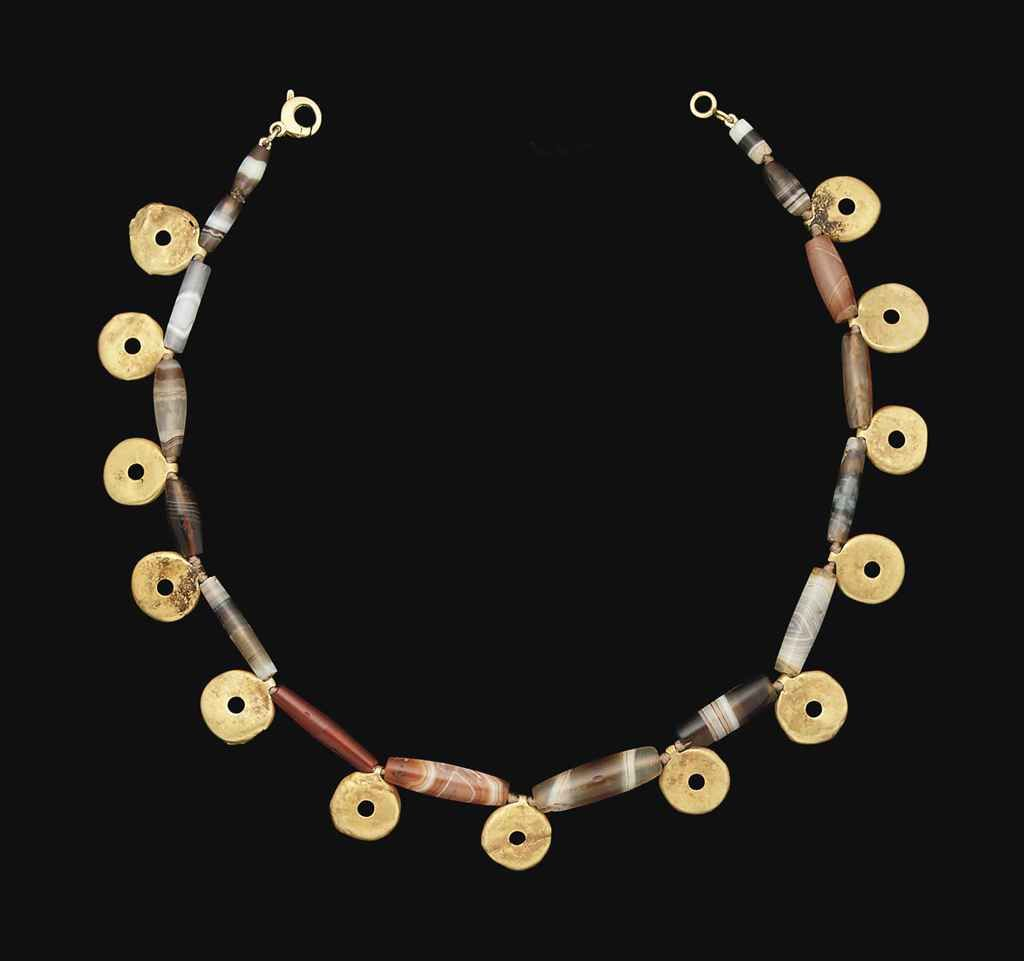 Lot 230 AN ANATOLIAN GOLD AND BANDED AGATE BEAD NECKLACE  CIRCA LATE 3RD MILLENNIUM B.C.