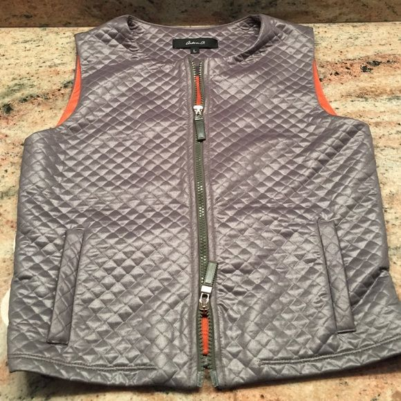 Army green crossed stitched vest Zipper closure that opens from the bottom and top. Hits at hip and slim fit. Two faux pockets in the front. Orange lined inside. I think fits more like a medium. Arden B Jackets & Coats Vests