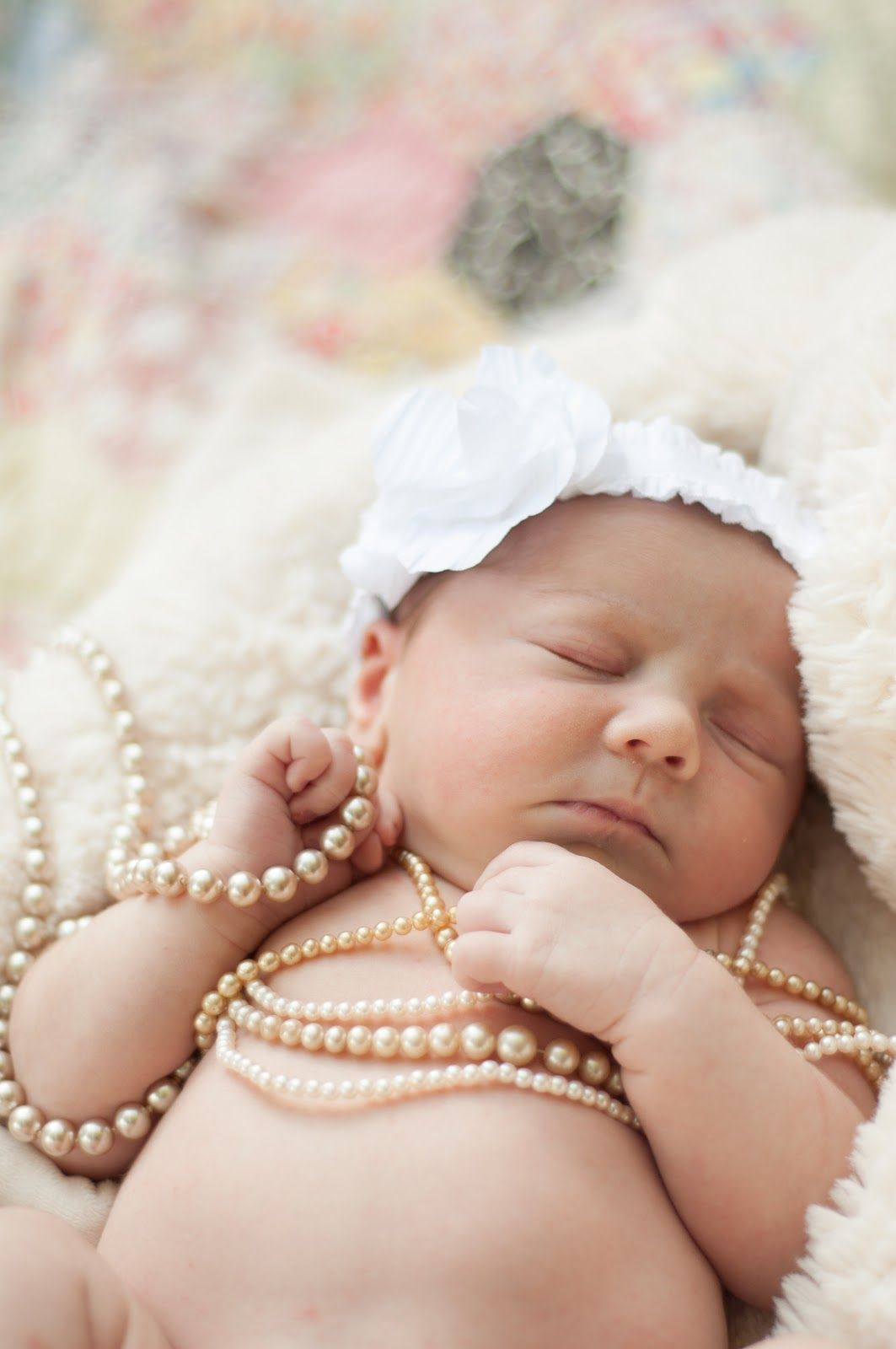 Newborn girl pearls love this but would do it with feather headband instead pic baby
