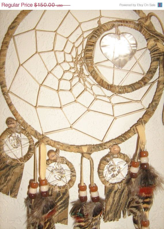 14 inch-Dreamcatcher mobile is hand woven with Zebra Printed leather and Zebra feathers. Each tiny dreamcatcher dangle has a star with a crystal