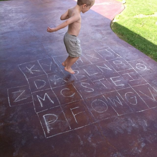 Use chalk to draw an alphabet hopscotch board Put most mon