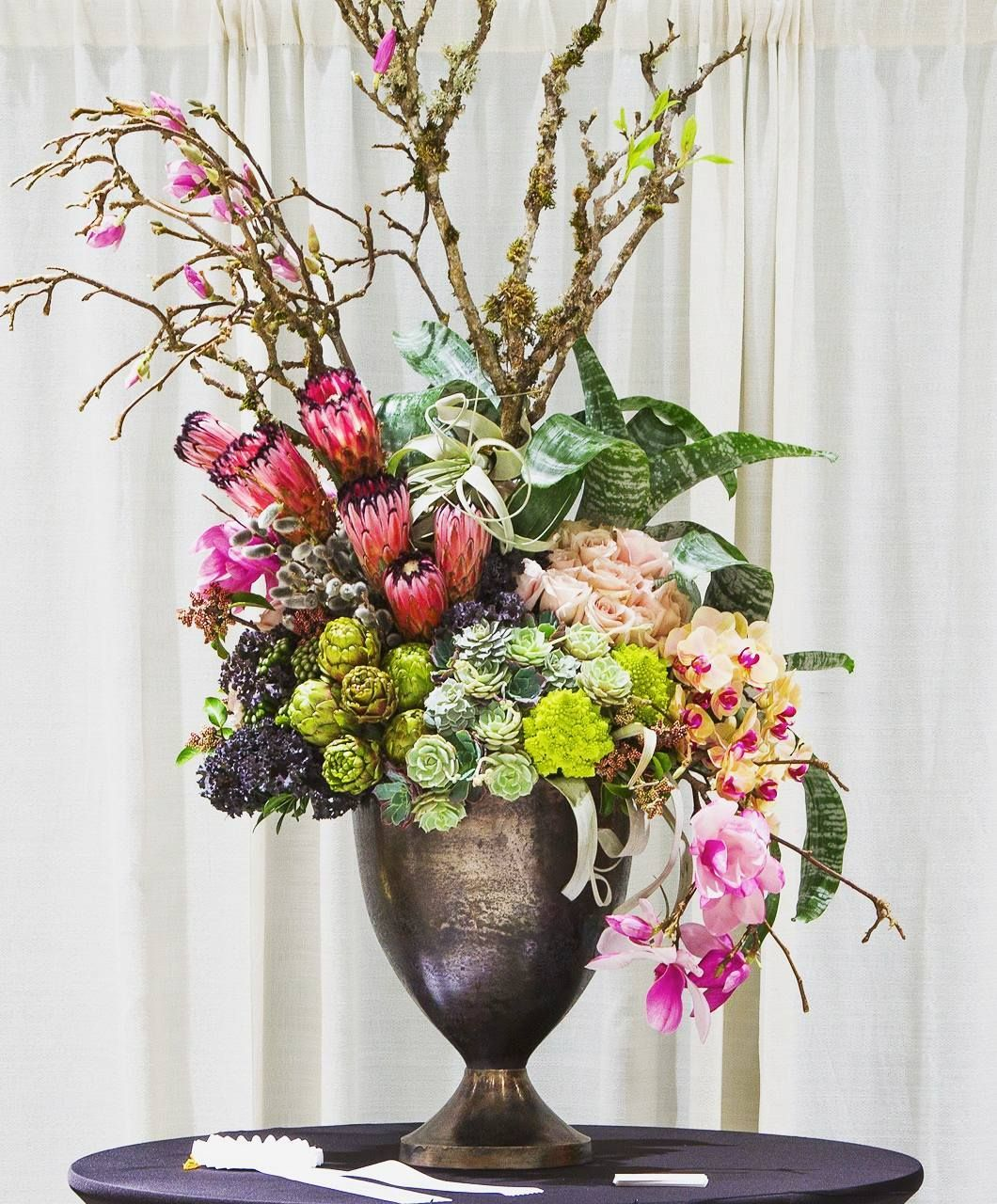 Succulents Artichokes & Airplants oh my! This striking