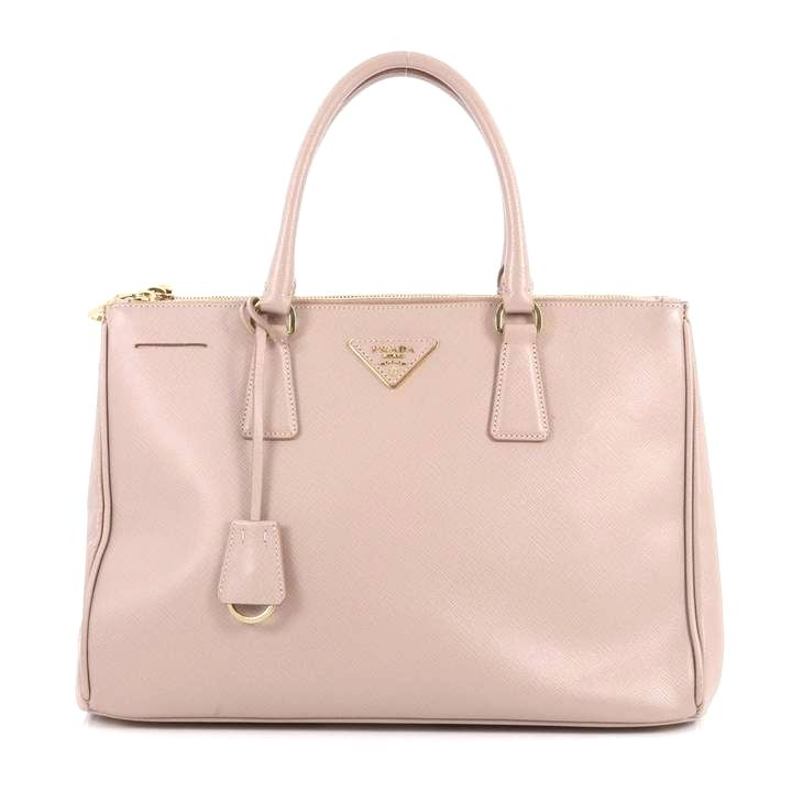 6135331af483 This authentic Prada Double Zip Lux Tote Saffiano Leather Small is the perfect  bag to complete any outfit. Crafted from light pink saffiano leather