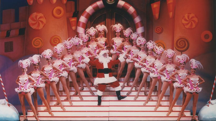 "Pete Menefee designed the ""Candy Cane Bizzazz"" costume for the Christmas show with Santa in 1990."