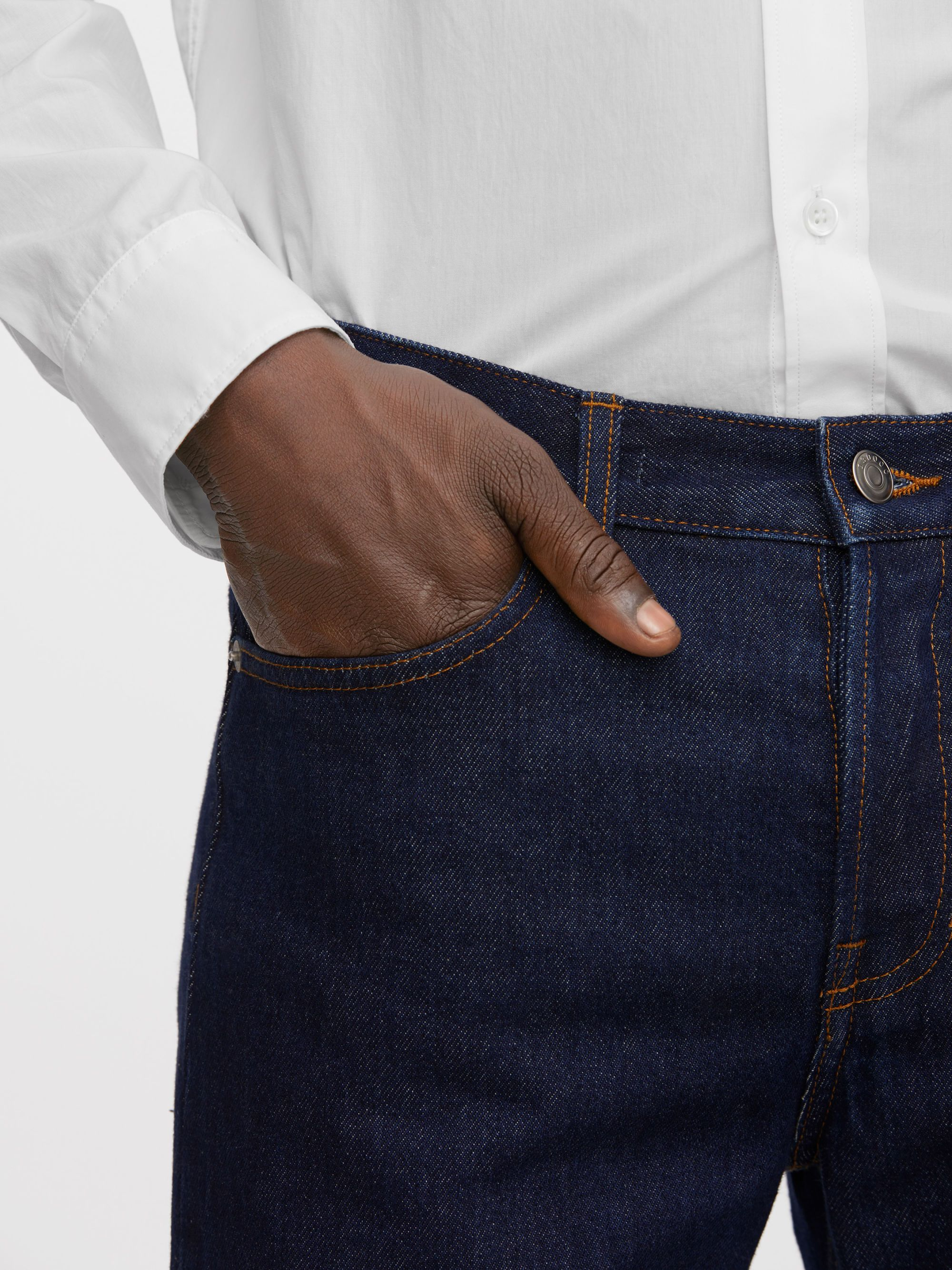 130002-265 - Standard Rinsed Indigo Jeans. A classic 5-pocket design, these regular-fit trousers are fashioned from rigid denim twill with a rinsed indigo look. 14 oz. #ARKET