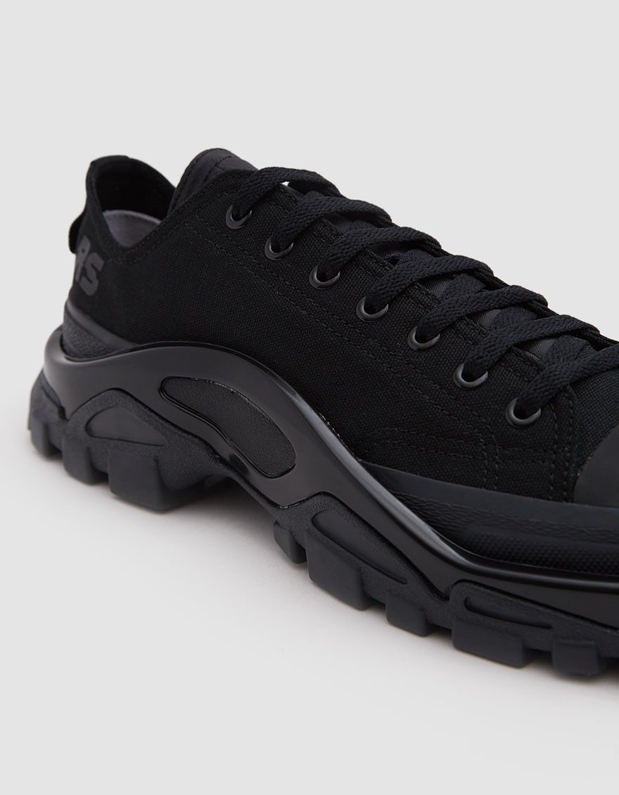 8268d40a6f5e39 Luxury runner from Adidas in collaboration with Raf Simons in Core Black