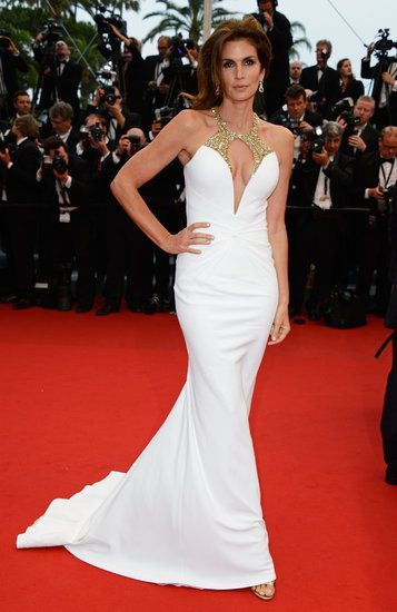 Cindy Crawford wore a curve-hugging white gown at this year's #cannes film festival.