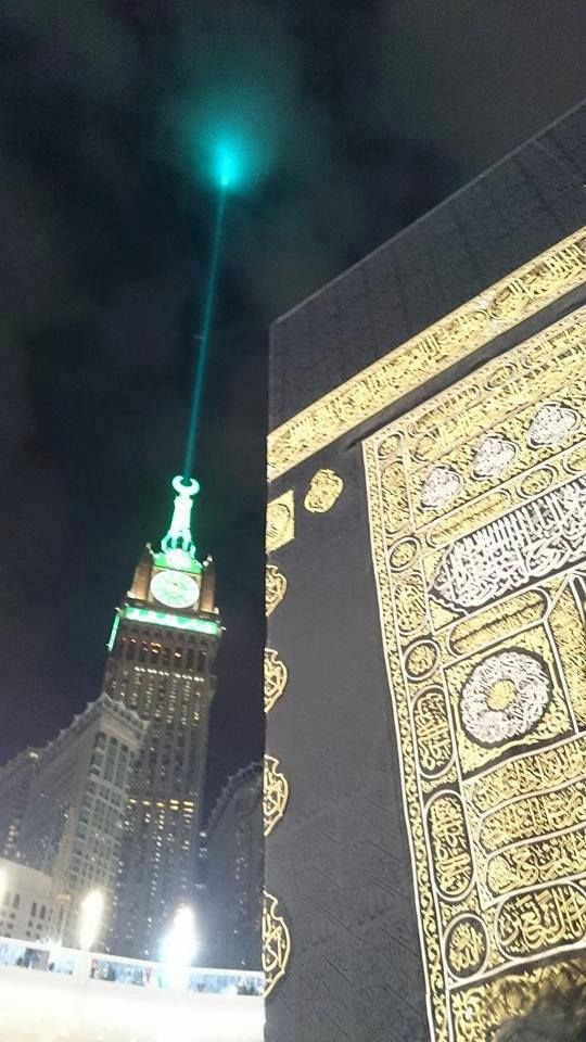 On 12th December The Green Laser Lights From The Top Edge Of Zamzam Clock Tower Makes The Environment Beau Clock Tower Green Laser Laser Lights