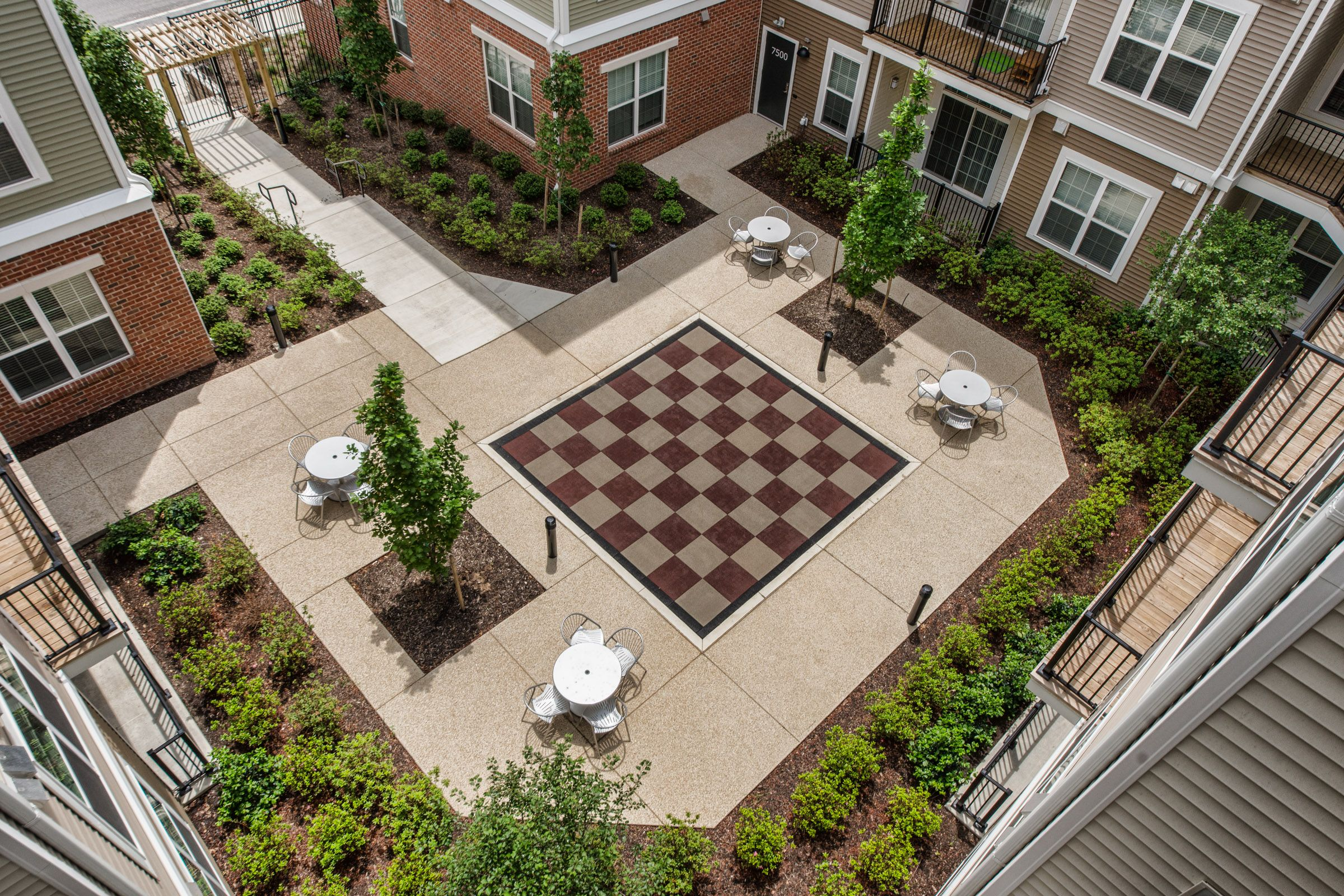 Verde Apartments At Howard Square Howard County Md Courtyard Design Courtyard Landscaping Courtyard Apartments