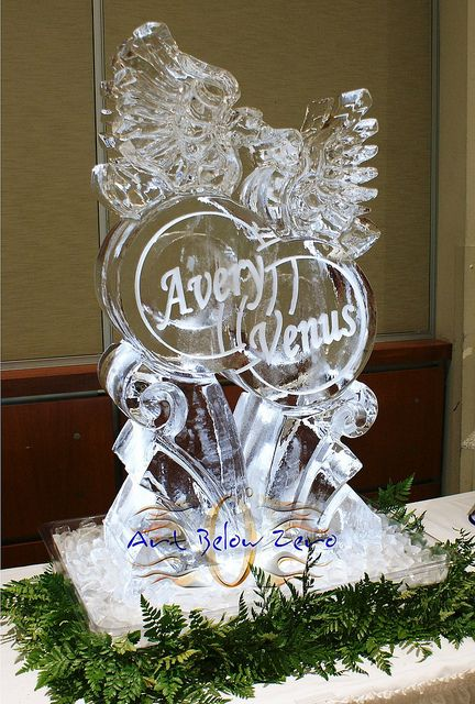 Three piece ice sculpture for a wedding reception. (After ...