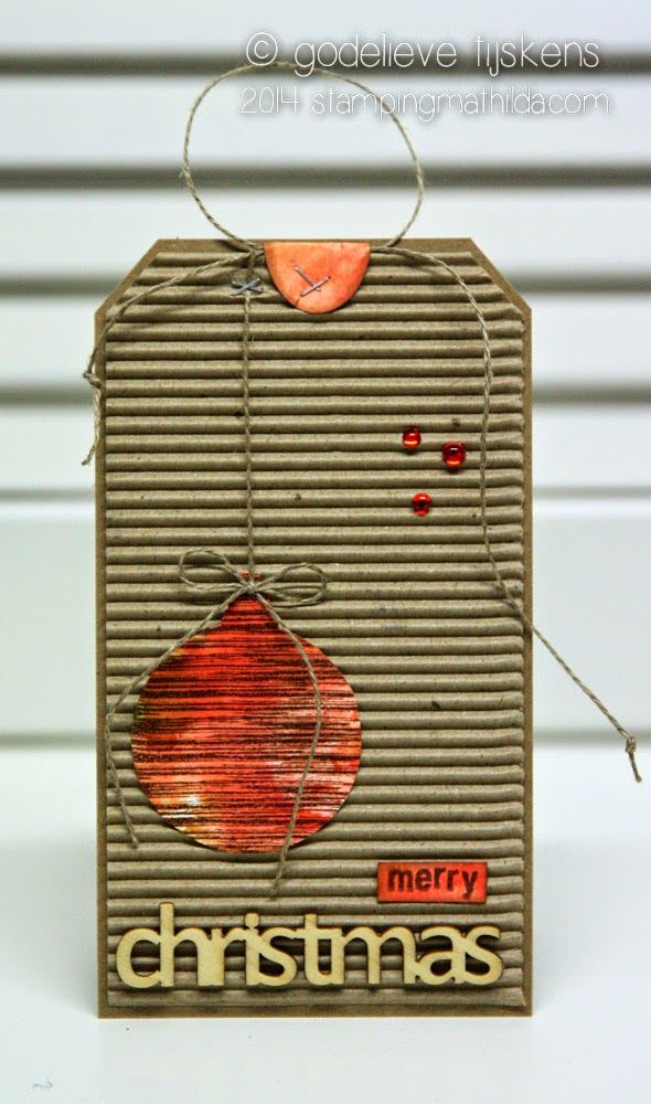 Corrugated cardboard and Darkroom Door stamps were used to create this Christmas tag. Ribkarton...