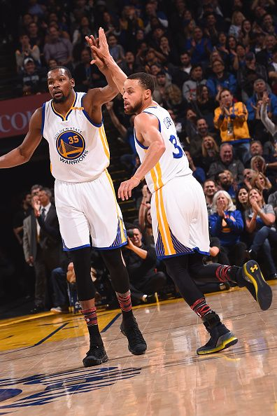 96398ba8d504 Kevin Durant and Stephen Curry of the Golden State Warriors high five  during the game against the Charlotte Hornets on February 1 2017 at ORACLE.