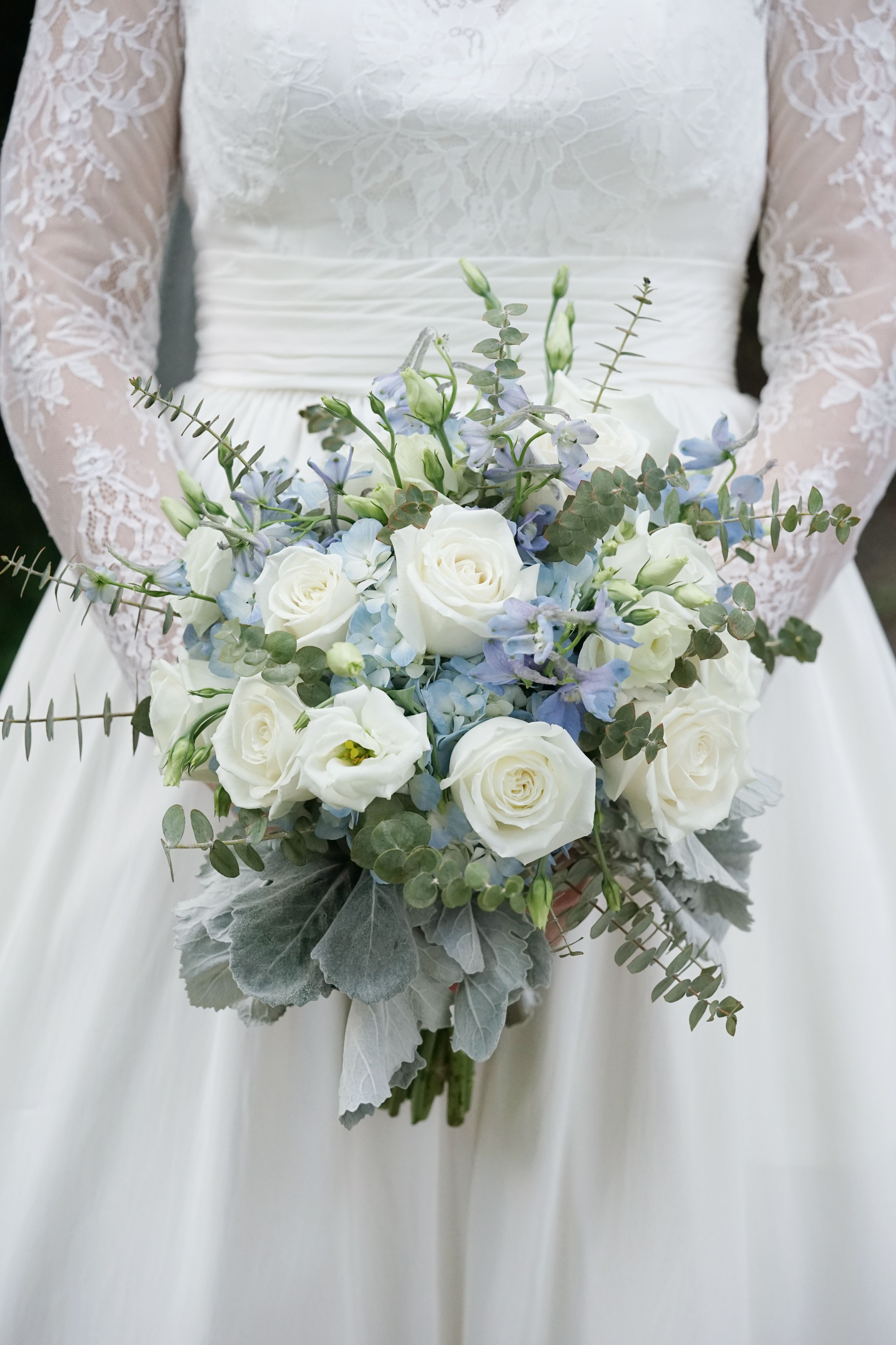 Round Bridal Bouquet Of Light Blue Delphinium White Roses