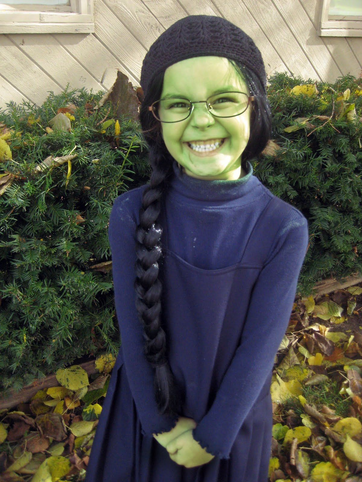 Little girl dressed like Elphaba. Cutest. Costume. Ever. One of my little girls will have to do this someday... how adorable!