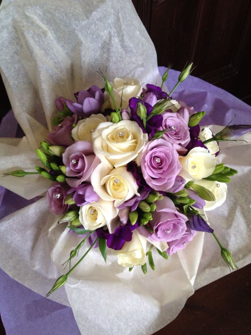 Lilac purple and white brides bouquet rustic wedding