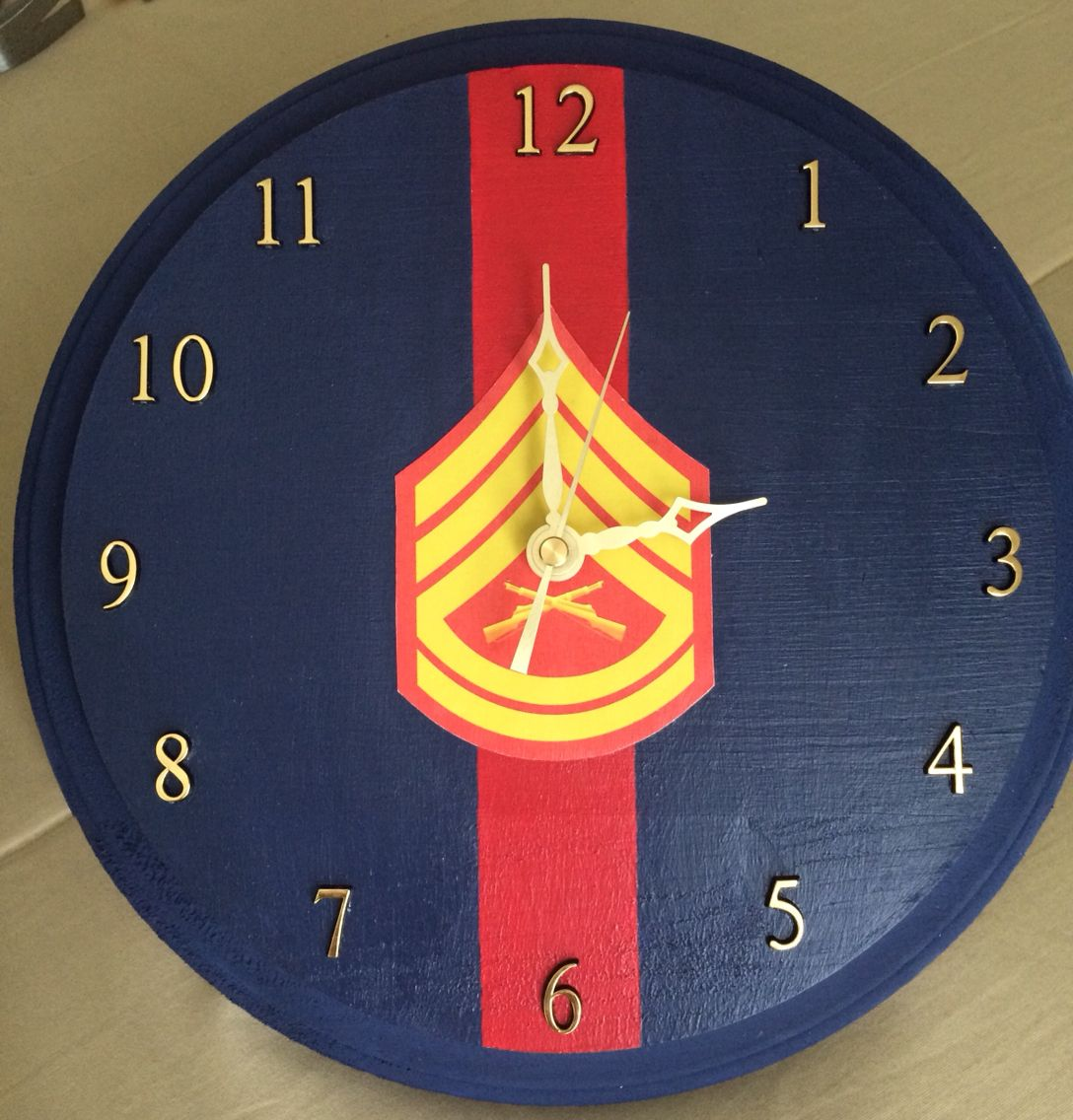 DIY Marine Corps GySgt clock for my husband's retirement. Buy a clock base (used wooden one from Michaels), paint, mod podge insignia to center and use basic clock kit to add finishing touches.