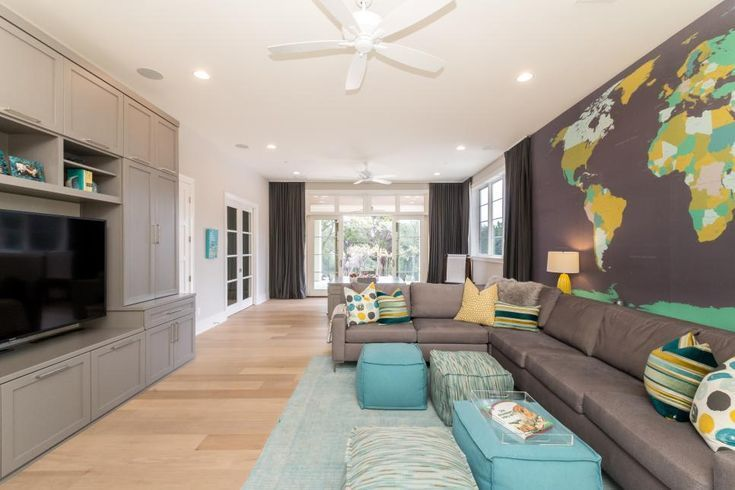 In this fun and kid-friendly family room a map of the world pops out from the w  In this fun and kid-friendly family room a map of the world pops out from the w  #Family #Fun #KidFriendly #Map #pops #Room #World