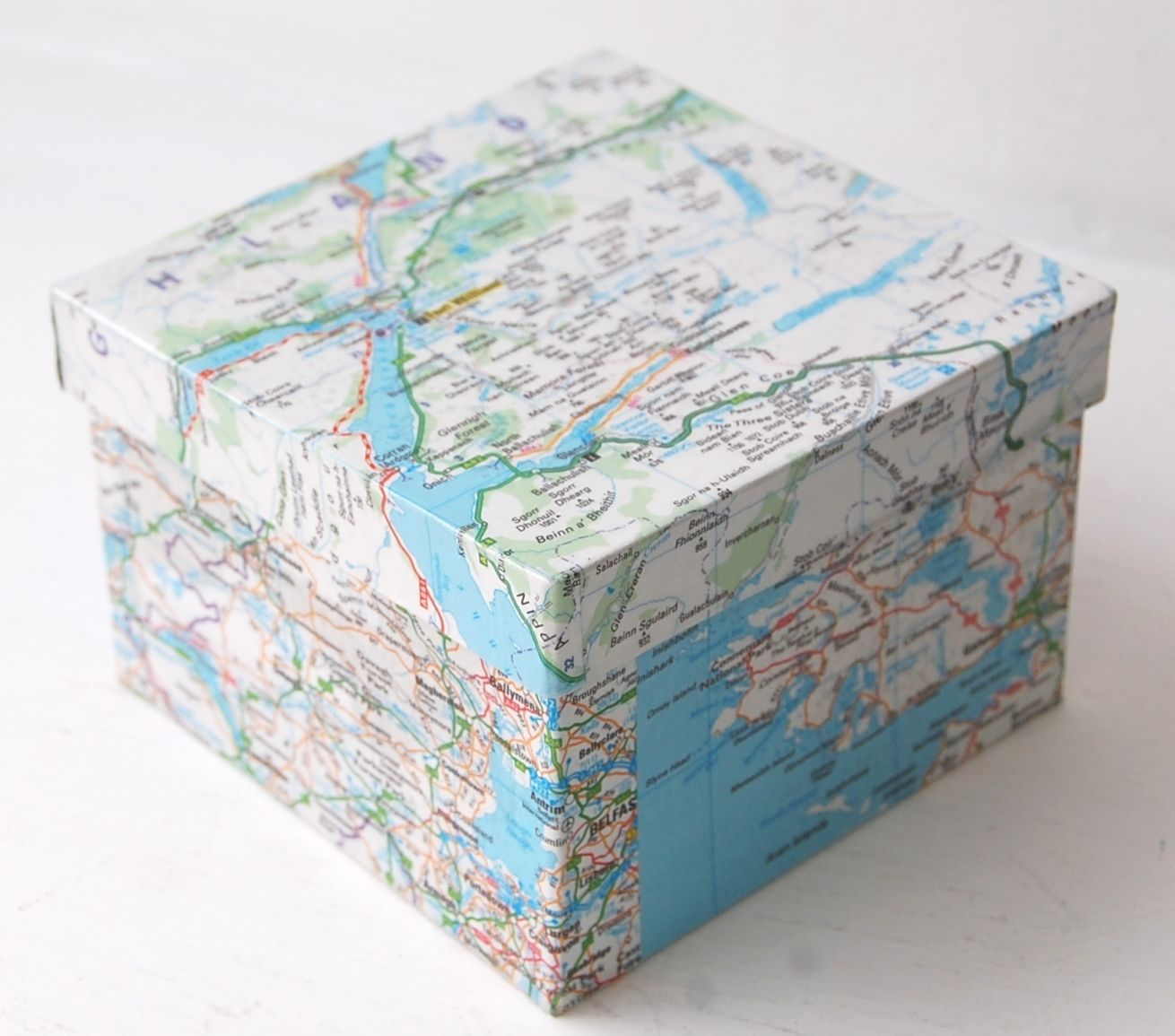 Decoupage a map onto a wooden box or fold a box directly ...