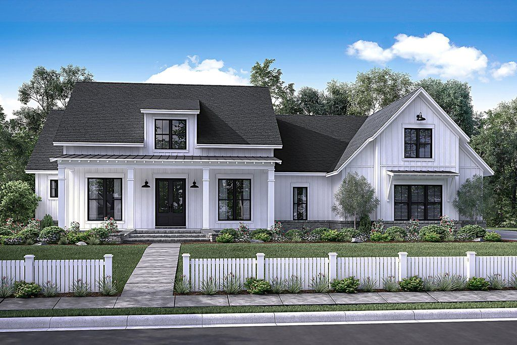 Theres no shortage of curb appeal for this beautiful 4 bedroom modern farmhouse plan the beautiful formal entry and dining room open into a large open