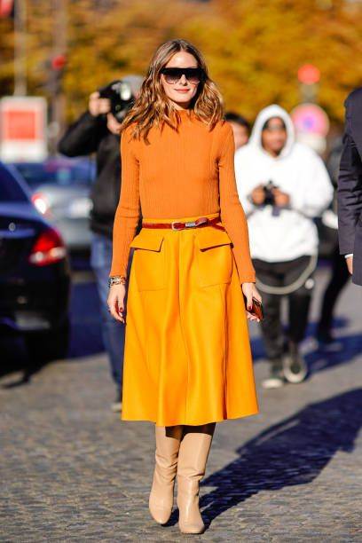 Olivia Palermo wears an orange turtleneck top an orange skirt a belt outside Rochas during Paris Fashion Week Womenswear Spring/Summer 2019 on...