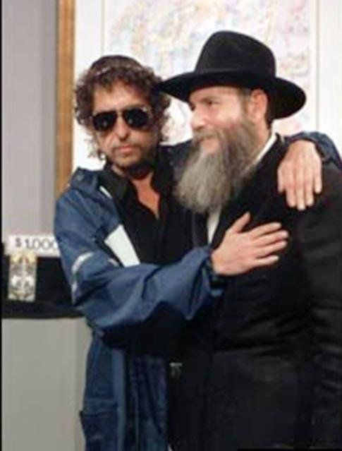July [?] 1994 This is a photograph of Bob Dylan meeting Rabbi David Pinto, reportedly in Paris during the European leg of his 1994 tour. Bob is pictured wearing a traditional Jewish kippah (כִּיפָּה) which is also known as a yarmulke. This is a round skull-cap usually made of cloth that fulfills the customary requirement that the head should be covered at all times.