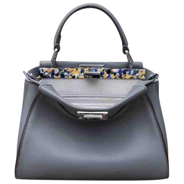 09bbc4a28d08 Peekaboo leather handbag   Pinterest   Luxury consignment, Store ...