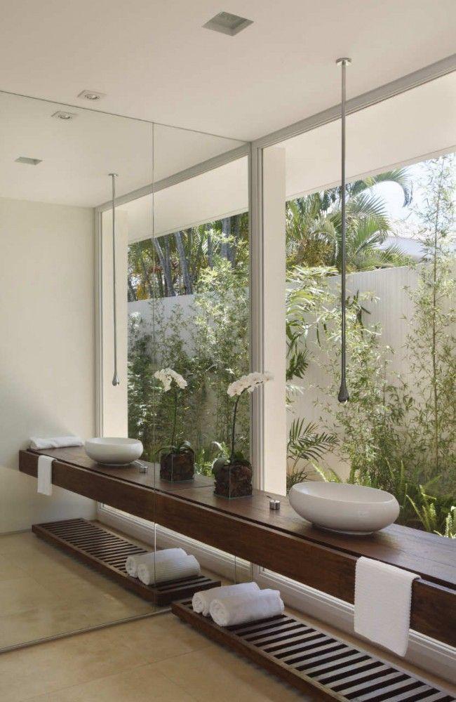 Earthy modern bathroom overlooking tropical plants - Decoist