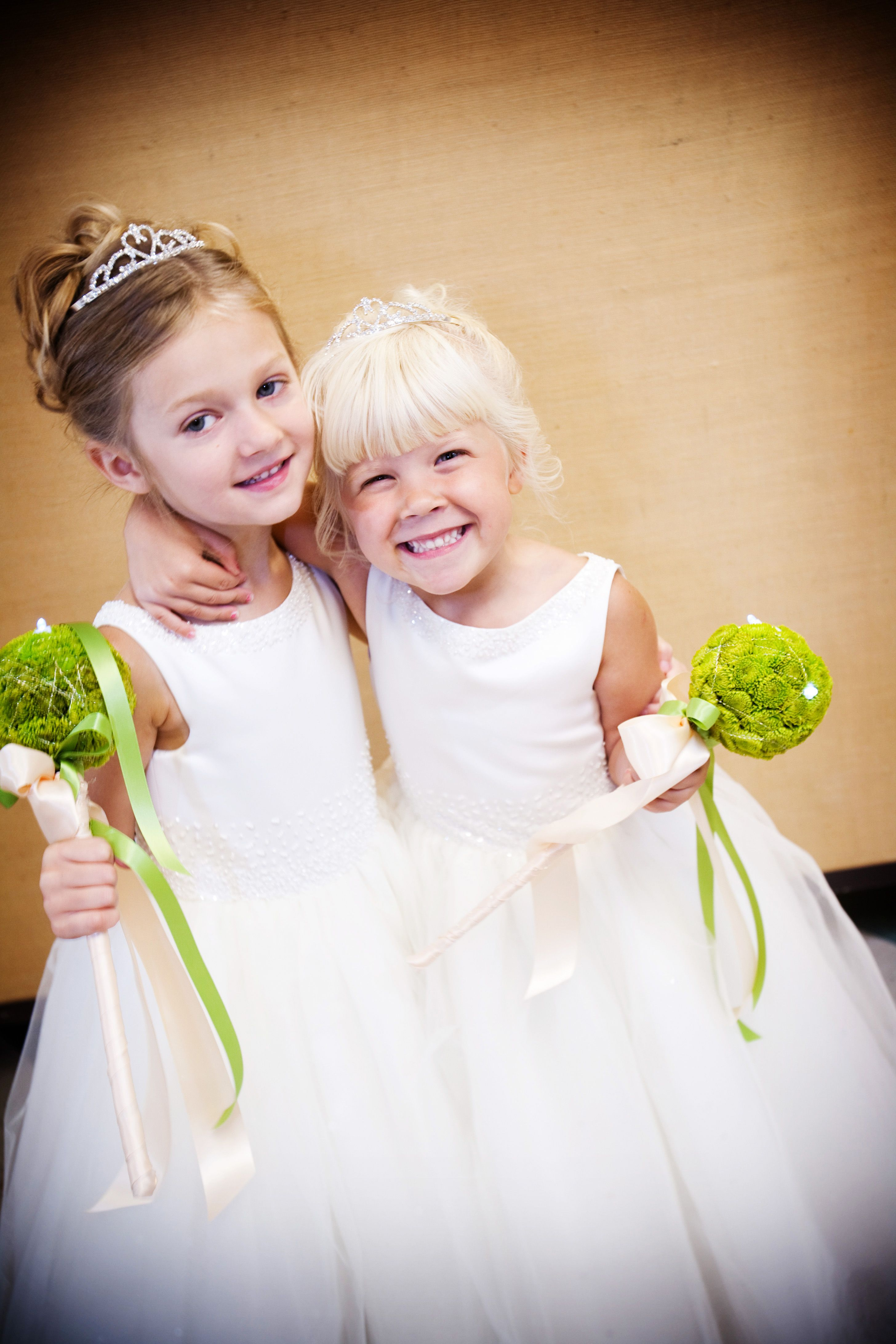 These flower girls are adorable the best part is their cute flower