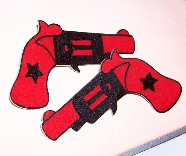 1 pair red and black gun pistol hair clips. $16.00, via Etsy.