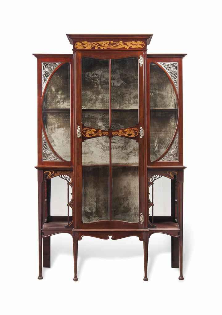 An edwardian art nouveau inlaid mahogany and silvered copper display cabinet