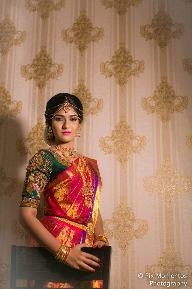 South Indian bride. Gold Indian bridal jewelry.Temple jewelry. Jhumkis.Red silk kanchipuram sari with contrast green blouse.Braid with fresh jasmine flowers. Tamil bride. Telugu bride. Kannada bride. Hindu bride. Malayalee bride.Kerala bride.South Indian wedding. #Saree;