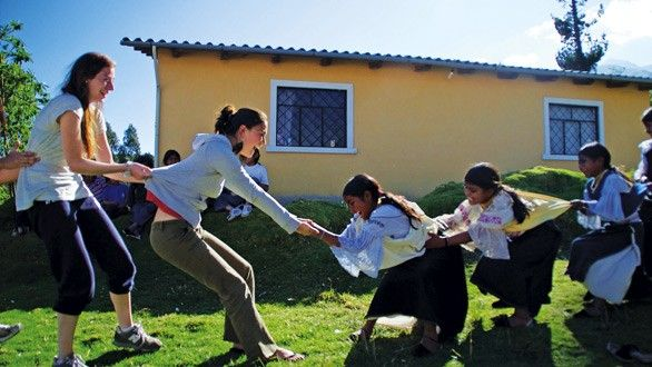 Playing a silly game of tug of war with the local school girls!