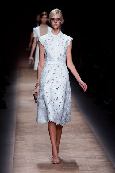Valentino Spring 2013/ Paris:  This was a study in timeless style. Chiuri and Piccioli used such a light hand with layers of lace, stiff silks and architectural elements they incorporated into knee-length skirts and dresses. They balanced form and flou. Shapes were structured but still soft.    Read more: Paris Fashion Week Spring 2013 Runway Looks -    Harper's BAZAAR