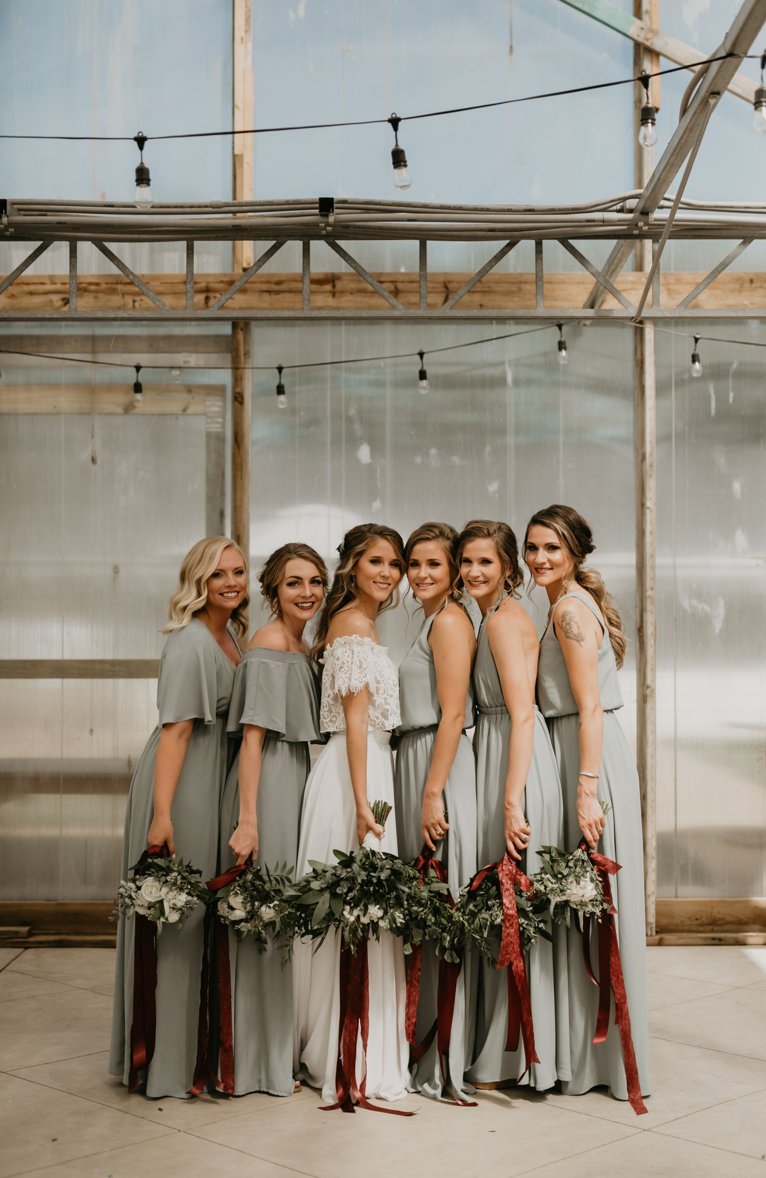 sage bridesmaid dresses with maroon accents