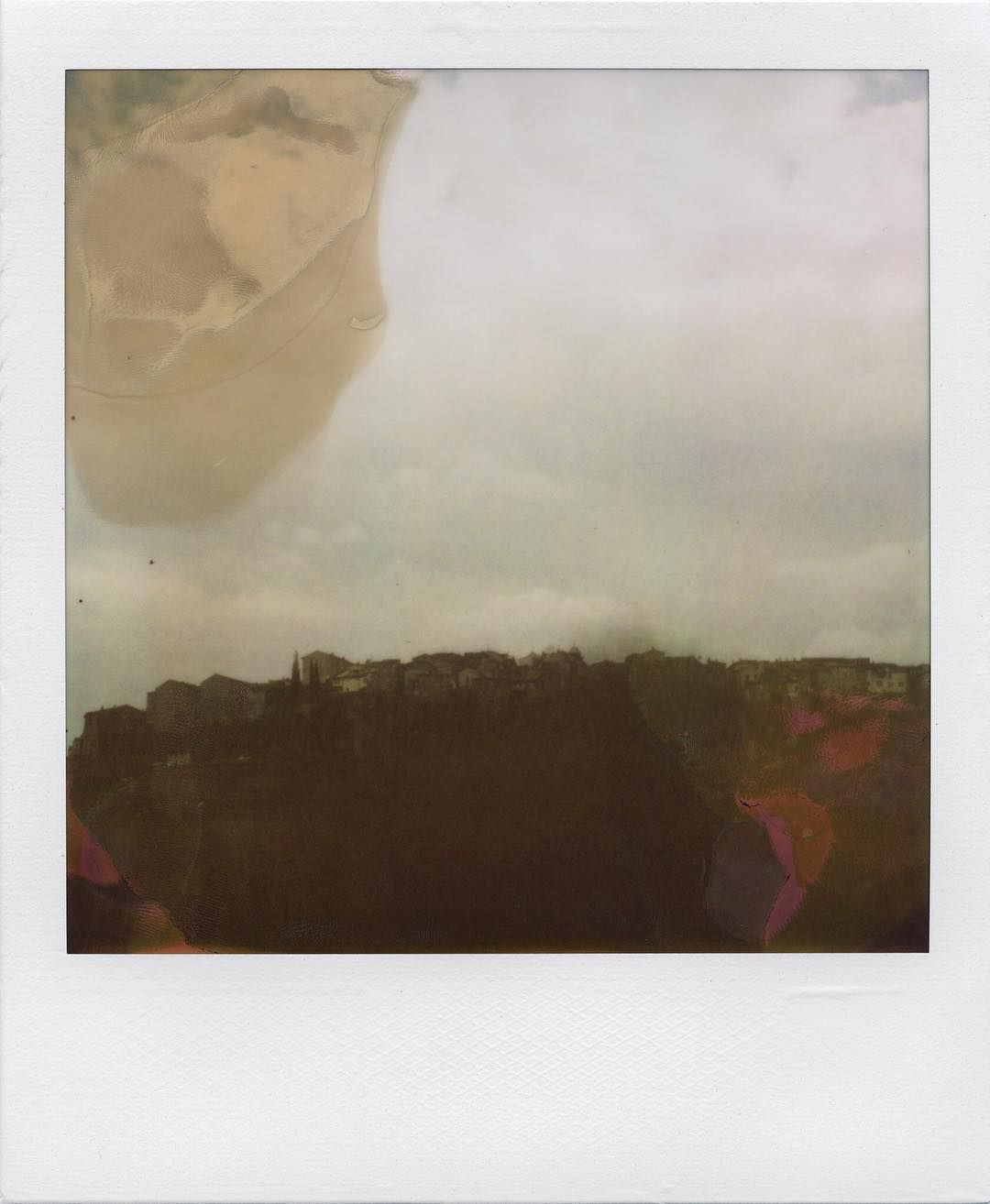 """Back in time (#Volterra 03/2010) #InstantPhotography #BelieveInFilm  Volterra on top of its beautiful hill through beautiful chemical blotches. Previously only available on my book """"Collected Instant Photography - Book Three 2010"""" at http://bit.ly/28KhwTP  #Polaroid SLR680 camera  779 #instant film  #heyfsc #squaremag #resourcemag #thefilmcommunity #analogfeatures #instantfilm #PolaroidOfTheDay #PolaroidIsNotDead #analogfeatures #analoguelove #filmphotographic #polavoid #Italy #Tuscany…"""