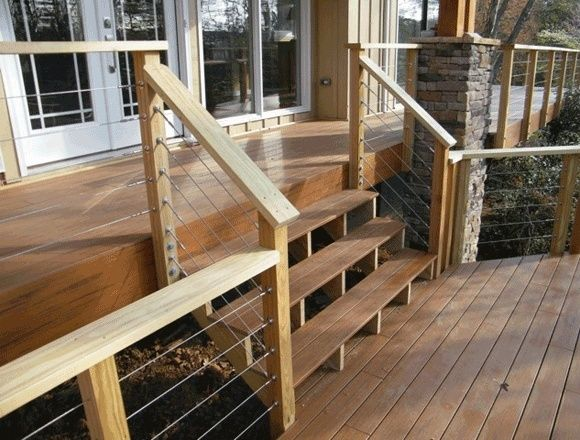 Deck with cable railing and stone supports for roof by ...