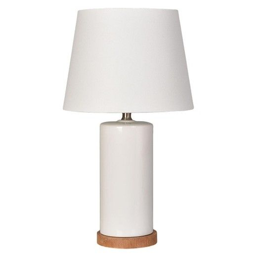 Pillowforts column table lamp brings modern style to your childs room its ceramic column has a glossy finish and sits on a sturdy wood base