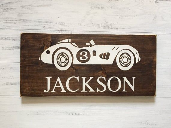 """Ready, Set, Gooooooo!  This vintage style car sign is the perfect compliment to a car-themed nursery or playroom.  This sign is available in 2 different sizes, 12""""h x 15""""l and 12""""h x 24""""l (24"""" long version is pictured.) The car's number can  be customized to match the recipient's age. And the text font can also changed to the more vintage style """"Cars"""" theme. The wood is a dark walnut stain with white hand painted text. Gentle sanding on the edges and corners gives the sign a unique rustic look.  A single protective coat of polyurethane seals the painting without a high gloss look. This handmade sign is crafted from whiteboard wood and a single bracket on the back allows for easy hanging.   All of our signs are handmade to order, no two signs are alike.  Your sign may vary slightly from what is pictured but that's what makes it special. ****Feel free to email us with any customization, requests or questions!  We'd be happy to hear from you!"""